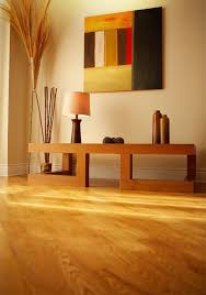 contemporary room with wooden furniture and wooden floor