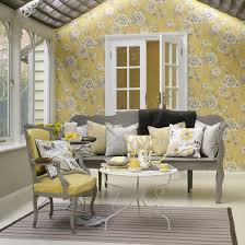 yellow conservatory with yellow and grey painted furniture