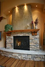 Home Interior:Interior Decor With Rustic Stone Fireplace And Wood Mantel  Near Gray Chair Interior