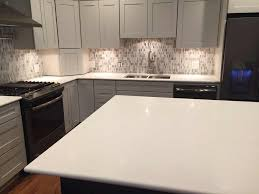 arctic white quartz countertops on white cabinets