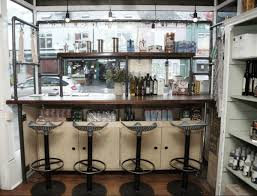 inside shot of Bragazzis window unit Reclaimed wood and steel gas pipe frame shop display furnitur
