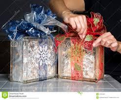 Glass Present Box Lights Glass Blocks With Christmas Ribbons And Lights Stock Image