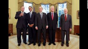 obama oval office. obama poses in the oval office with several former us presidents january 2009 from