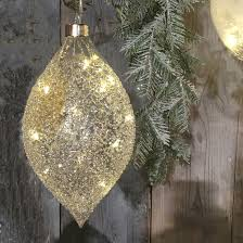 hanging glass teardrop shaped bauble filled with warm white led lights