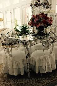 my client wanted to keep the shabby chic ruffled slipcovers but wanted them in