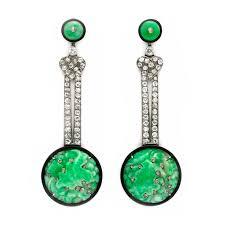 a pair of art deco carved jade enamel and diamond ear pendants circa 1925