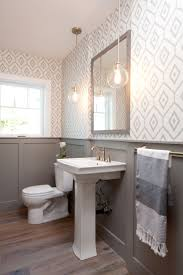 Modern Farmhouse Bath by Jaimee Rose Interiors. Love the gray wainscoting  and wallpaper