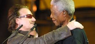 bono pens essay tribute to nelson mandela channel nelson mandela and bono embrace at the 46664 concert at green point stadium in cape town on 29 2003 anna zieminski afp