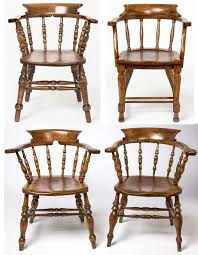 four individual english style captain or pub chairs each one slightly diffe but will
