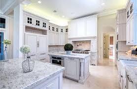 white granite countertops with white cabinets