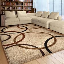 beige 9x12 area rug with brown rounds