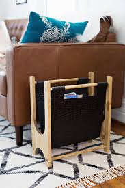 VIEW IN GALLERY Wood and Leather Magazine Rack