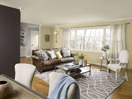 stunning brown and grey living room beige color wall brown accent wall white armchair brown leather
