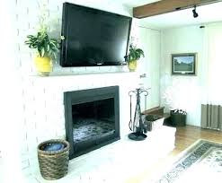 black brick fireplace painted surround with white ma