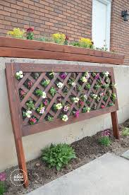 i thought about doing a pallet garden but after a bit of research we decided to come up with our own design vertical flower garden 1