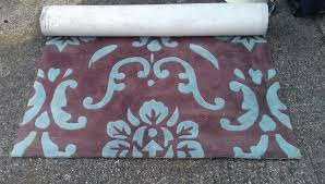 large brown and blue patterned rug