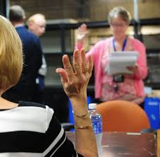 the daily reporter looks back on the most memorable moments of the pictured a volunteer s raised hand during an oath given by hancock county clerk marcia moore tom russo daily reporter