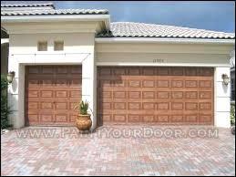3 car garage door door diva 3 car garage painted with faux wood finish 3 car 3 car garage door