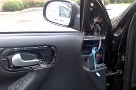 to detach the interior door panel there are six s that must be removed four are visible but the other two are concealed beneath the plastics around
