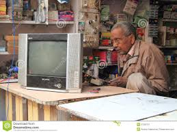 tv repair shop. editorial stock photo. download man is repairing tv in repair shop