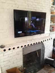 chic how to hide tv wires over brick fireplace with mounting tv brick fireplace