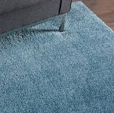 calvin klein s licensed home products have rolled out at bed bath beyond and includes the brand s area rugs made by nourison shown the plush brooklyn