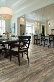 austin wood vinyl flooring with home stagers dining room rustic and plank floor