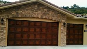 wood garage door builderPlainjanesteelbuildergrade garage doors stained to look like