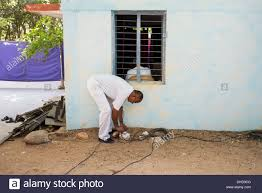 Indian man getting power from the bus generator to village school