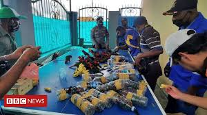 <b>Parrots</b> found stuffed in plastic bottles in Indonesia - BBC News