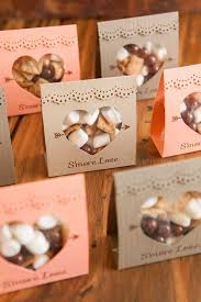 Use chocolate, marshmallow and mini graham crackers. Your guests will smile  when they see this at a fall, rustic or winter wedding.