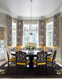 Dining Room Bay Window Covered With Short Curtains And Furnished With Round  Table And Armless Chairs With Yellow Pads