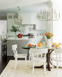 a backsplash and countertops of statuary marble marry gray and white tones in the new kitchen the breakfast area s chairs swamped in the flood