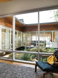 The plan of the house revolves around a rocky outcropping lush with life  that acts as