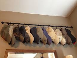 ball cap storage use an old curtain rod curtain ring clips to hats