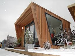 init studios garden office. green retreats have recently launched a striking new garden office init studios