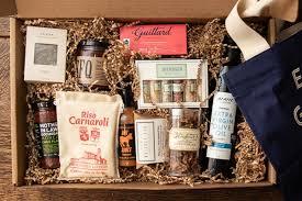 a cardboard box with a chocolate bar rice chili sauce olive oil