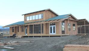 a low thermal mass sunspace an inside out mooney wall plus many material and labor saving construction ideas into a house that is energy efficient