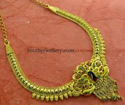 a traditional necklace perfect for weddings and festivals 22 carat gold necklace with intricate peacock pendant studded with rubies and emeralds by mehta
