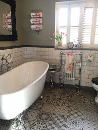 emma s traditional bathroom features a slipper style freestanding bath a vintage toilet and period heated