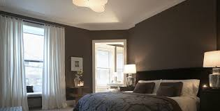 Luxurious chocolate brown bedroom with chocolate brown walls paint color,  black headboard, brown & purple blanket bedspread & pillows, mercury glass  lamps ...