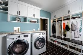 Custom laundry storage solutions with cabinets and mud room organization  system