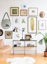 once your wall is fully decorated spruce up the surrounding area with plants and other accent items like this modern lamp wicker chair and cozy shearling