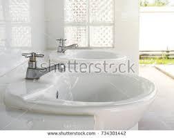 public bathroom sink. Public Bathroom Concept Of Cleanliness And Hygiene. Metal Tap Public Sink S