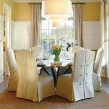 traditional dining room with fabric chair covers neutral color