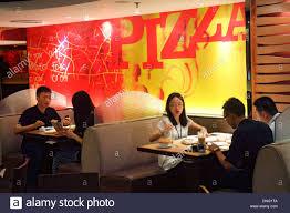 pizza hut restaurant inside. Interesting Pizza Beijing China The Malls At Oriental Plaza Pizza Hut Restaurant Inside  Interior Asian Woman Man Tables Intended Restaurant Inside D