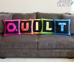 Jaybird Quilts & I even made a set of QUILT pillows for my couch! Adamdwight.com