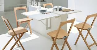 very small modern dining room design with double wall mounted drop leaf dining table with 4 wood folding chairs and all white furniture and wall interior