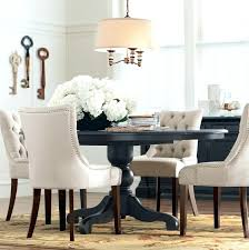 black and white round table a round dining table makes for more intimate gatherings black white table decorations party