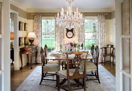amazing dining room crystal chandelier over elegant table with stained wooden chairs